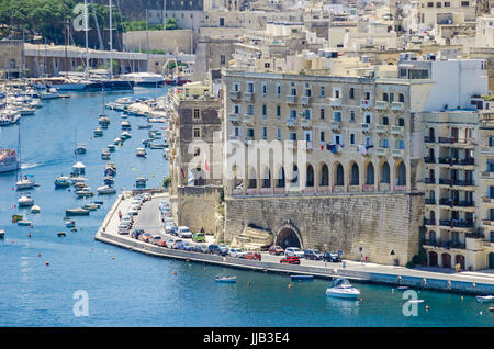 Senglea, Malta - June 4, 2017:  Senglea waterfront as seen from the Grand Harbour, its modern part with limestone - Stock Photo