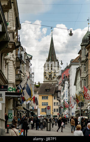 St. Peter Church clock tower, the largest clock face in Europe,  watches over the busy and historic Rennweg Street, - Stock Photo