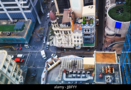 Aerial view of busy Sydney city streets in business downtown during day with people and cars crowding the King street - Stock Photo