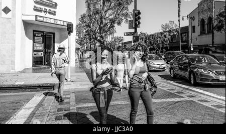 Stylish people on Hollywood Boulevard in Los Angeles - LOS ANGELES - CALIFORNIA - APRIL 20, 2017 - Stock Photo