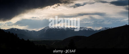 Stormy weather passing over Jackson and Highway 22 between the Teton Mountains and Snow King. Bridger-Teton National - Stock Photo