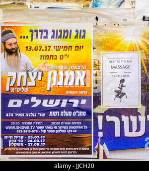JERUSALEM, ISRAEL - JULY 12, 2017: Combination of posters about religious preaching, and massages, in the ultra - Stock Photo