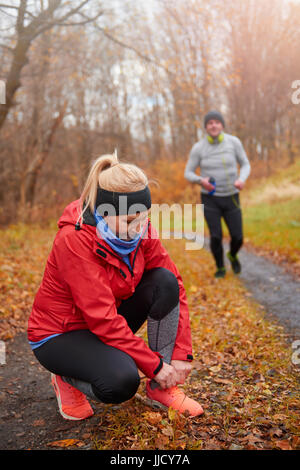 Main view of adult runners in the woodland - Stock Photo