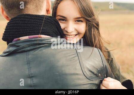 Young modern stylish couple outdoors. Romantic young couple in love outdoors in the countryside - Stock Photo
