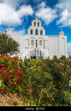 Traditional Greek orthodox church with belfry in Pyrgos, Santorini, South Aegean, Greece - Stock Photo