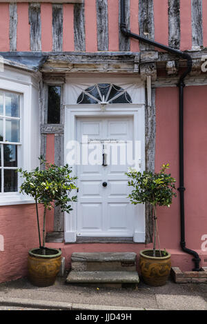 Picturesque Door in Lavenham with Plants Either Side - Stock Photo
