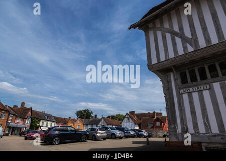 Wide View of Lavenham Market Place on Bright Summers Day - Stock Photo