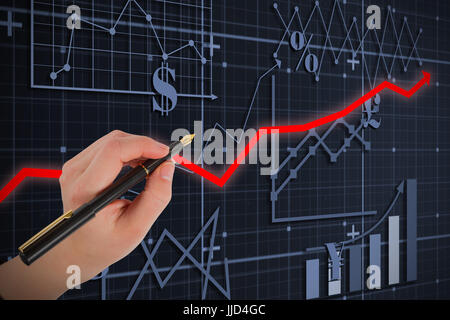 Businesswomans hand writing with fountain pen against red arrow - Stock Photo