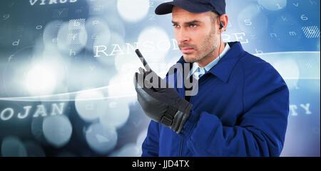 Focused security officer talking on walkie talkie  against virus background - Stock Photo