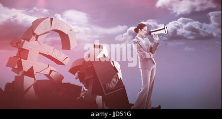 Portrait of a businesswoman shouting through a megaphone against blue sky - Stock Photo