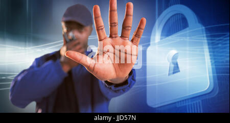 Confident security talking on walkie talkie and making stop gesture against virus background - Stock Photo