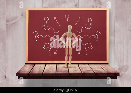 3d image of figurine standing with hands on hip against board on a wooden shelf - Stock Photo