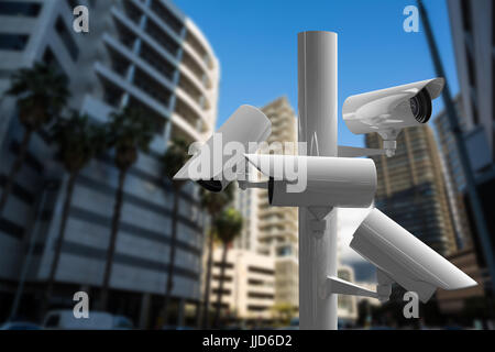 CCTV camera against buildings in city - Stock Photo