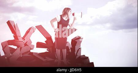 Businesswoman shouting through megaphone against blue sky - Stock Photo