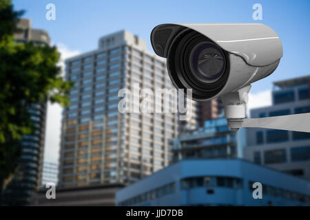 CCTV camera against beautiful cityscape against clear sky - Stock Photo