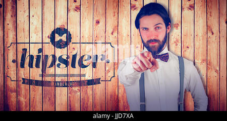 Portrait of man pointing finger against view of wooden planks - Stock Photo