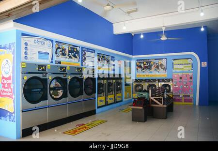 Penang, Malaysia - Mar 10, 2016. Automatic washing machines at laundry service in Penang, Malaysia. - Stock Photo