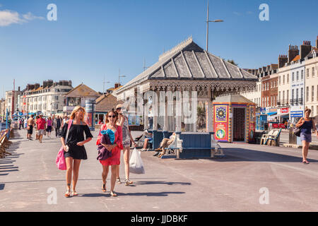 2 July 2017: Weymouth, Dorset, England, UK - Visitors on the Promenade on a hot summer day in July. - Stock Photo