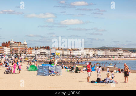 2 July 2017: Weymouth, Dorset, England, UK - People sunbathing on the busy beach on a hot summer day. - Stock Photo