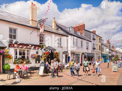 3 July 2017:  Sidmouth, Dorset, England, UK - Shoppers in Old Fore Street, beside The Anchor Inn, on a sunny summer - Stock Photo