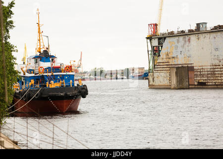 Shipyard industry, ship building,floating dry dock in shipyard - Stock Photo