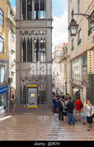 Lisbon Elevador de Santa Justa, tourists queue to enter the Eiffel-inspired Elevador de Santa Justa  in the Baixa - Stock Photo