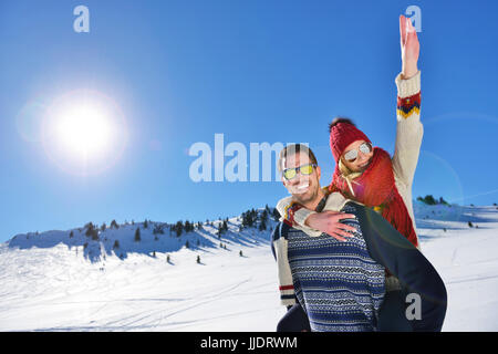 Loving couple playing together in snow outdoor. - Stock Photo
