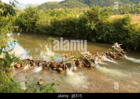 Small dam with generation of hydro electricity production - Stock Photo