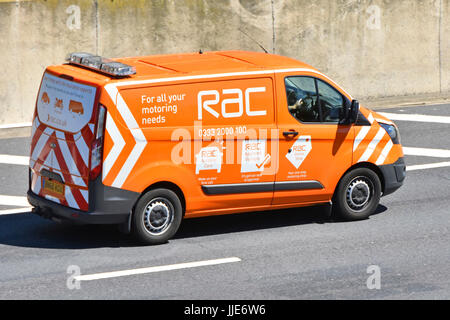 RAC breakdown van driving along UK motorway adverts on side of van advertising other services beyond breakdown and - Stock Photo