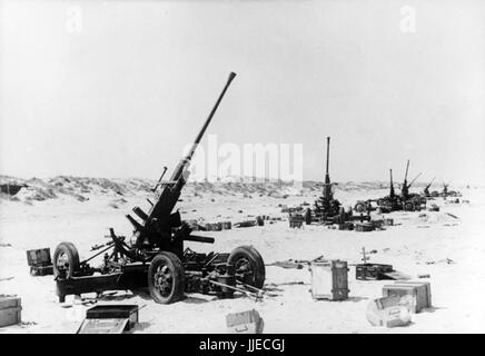 The Nazi propaganda image shows German Wehrmacht shows British anti-aircraft (flak) cannons in French Dunkirk after - Stock Photo