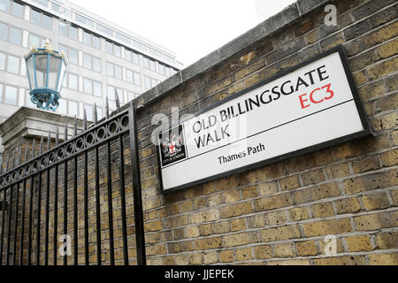 Old Billingsgate Walk EC3 street sign on the River Thames Path and a vintage gas lamp in The City of London, England - Stock Photo