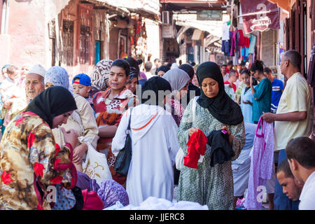 Busy shopping street Marrakech Morocco women market - Stock Photo