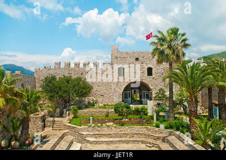 view of Marmaris castle and museum with small garden and Turkish flag on top, Marmaris, Turkey - Stock Photo