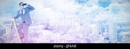 Businessman looking through binoculars while standing on ladder  against stocks and shares - Stock Photo