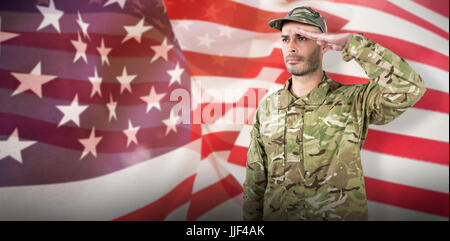 Confident soldier saluting against focus on usa flag - Stock Photo