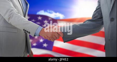 Business handshake against composite image of american flag - Stock Photo
