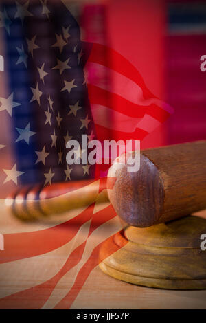 Focus on usa FLAG against close-up of judges gavel - Stock Photo