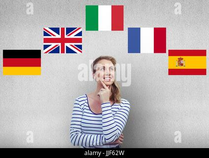 Digital composite of main language flags around young happy woman thinking. - Stock Photo
