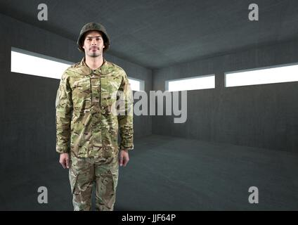 Digital composite of soldier with helmet in dark concrete room - Stock Photo