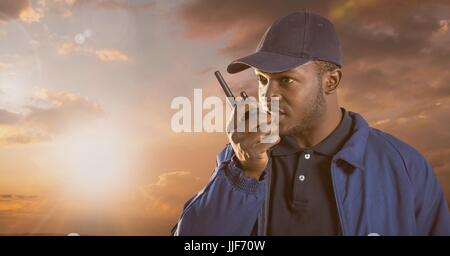Digital composite of Security man outside with cloudy sky - Stock Photo