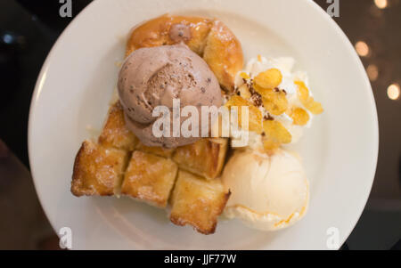 Honey toast with chocolate and Vanilla ice cream - Stock Photo