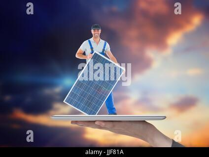 Digital composite of builder with solar panel on tablet on the hand. Sky background - Stock Photo