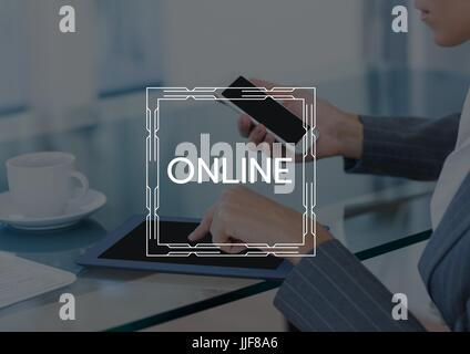 Digital composite of Online text and graphic against business woman with phone and tablet and dark overlay - Stock Photo