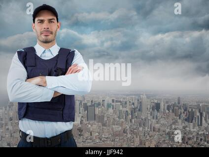 Digital composite of Security guard with arms folded against skyline and clouds - Stock Photo
