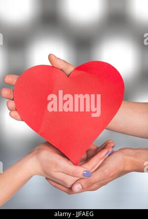Digital composite of Hands holding heart with sparkling light bokeh background - Stock Photo