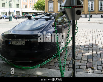 Electric car charging up on road side in Trondheim Norway