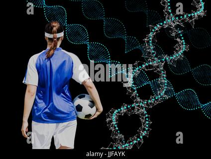 Digital composite of soccer woman with technological dna chains. Black background - Stock Photo