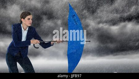 Digital composite of Business woman with umbrella and blocking rain against storm clouds - Stock Photo