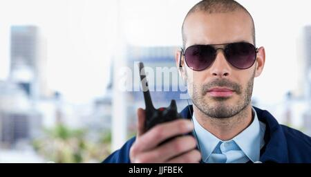 Digital composite of Security man in city - Stock Photo