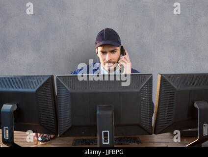 Digital composite of security guard behind the screens phoning - Stock Photo